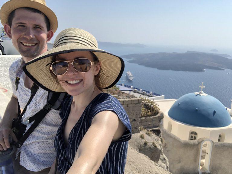 man and woman in Santorini greece
