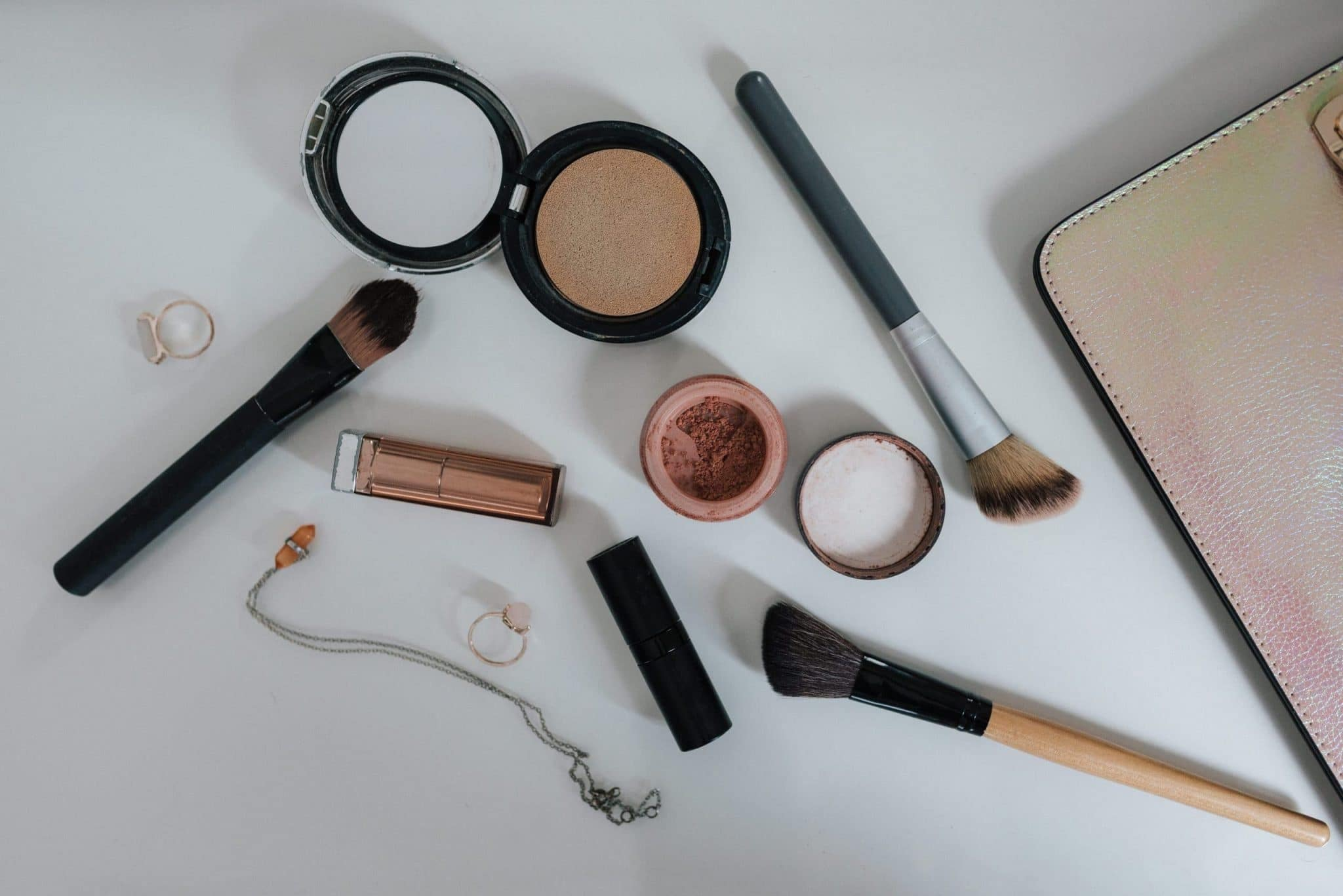 Flat Lay Photography of Makeup Brushes and Compacts