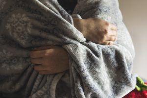 Person Covered with a Blanket