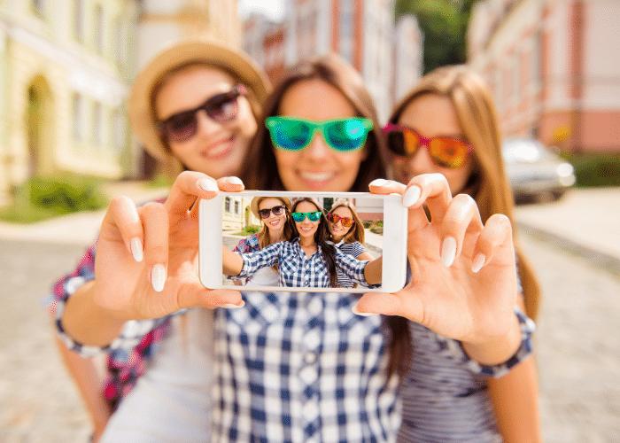 3 women taking a selfie on phone