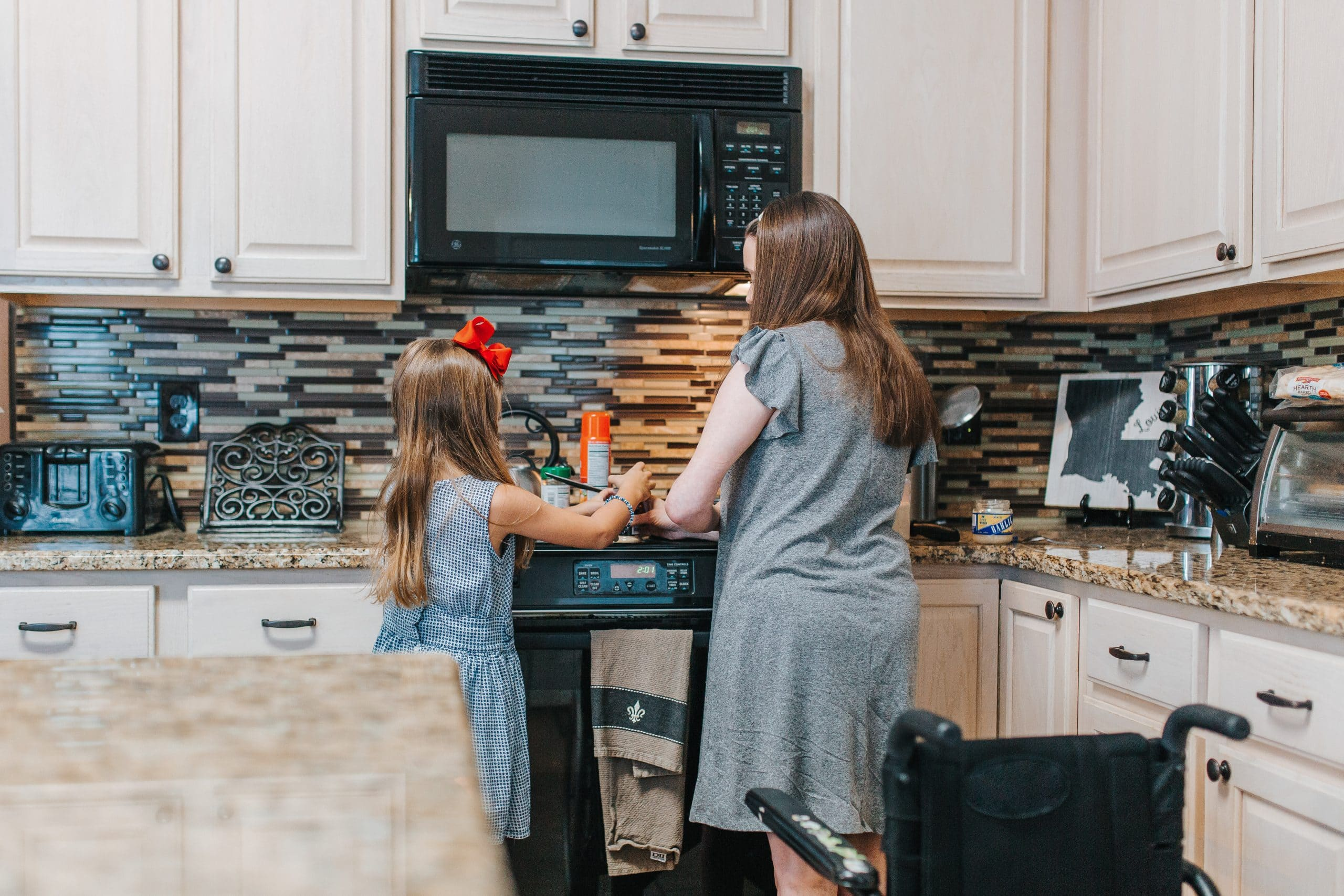 woman and daughter cooking