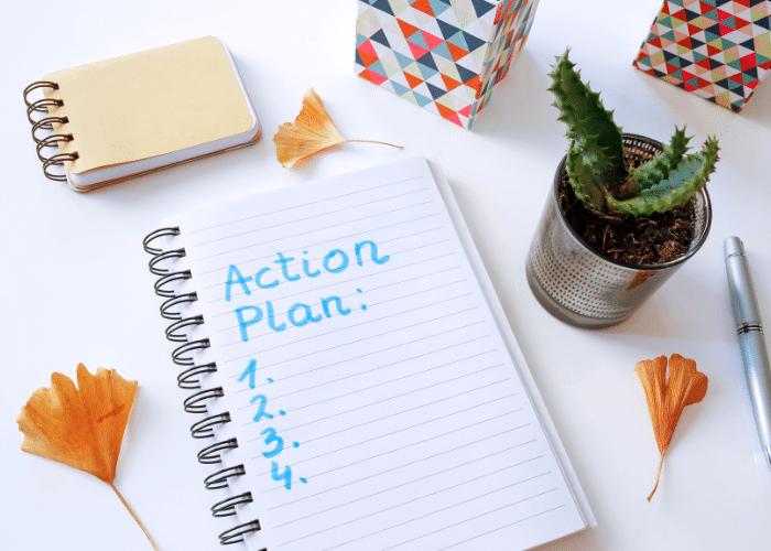 action plan written on notebook