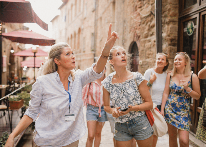 tour group with woman pointing up