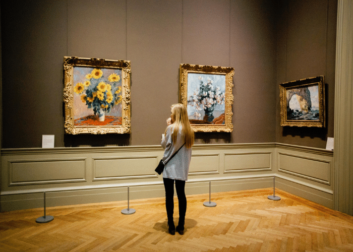 woman looking at painting in museum