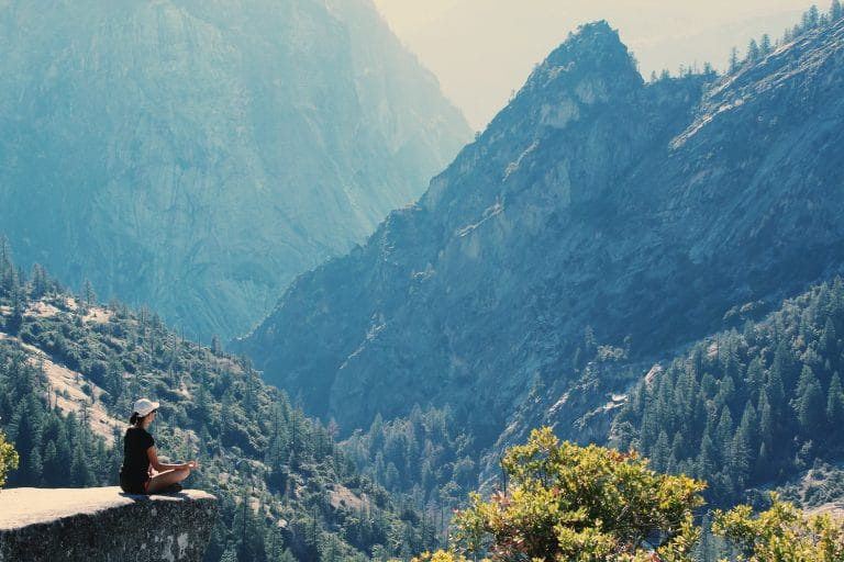 woman meditating in mountains