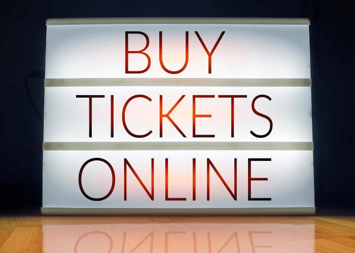 buy tickets online written on glowing board
