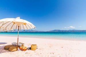 White and Brown Umbrella on Beach