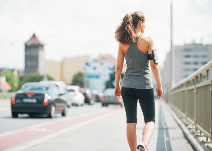 woman walking on side of road