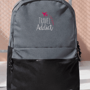 gray and black travel addict backpack
