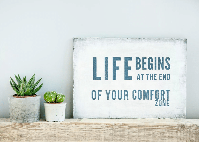 life begins at the end of your comfort zone written on board
