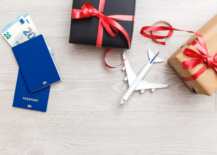 presents with mini airplane passports and money