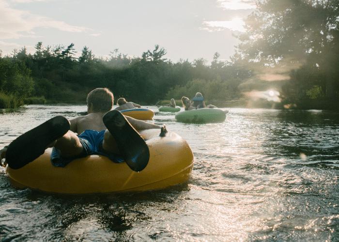 man tubing on river
