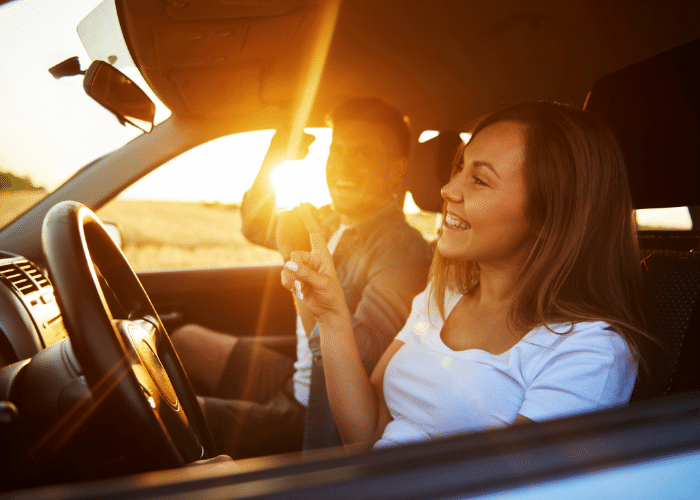 couple laughing in car