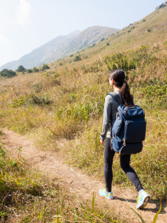 girl hiking with backpack
